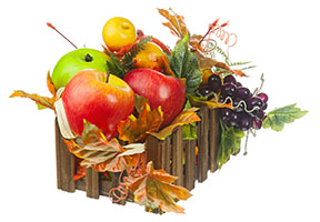 Composition from Artificial Fruits and Autumn Leaves in Wooden B